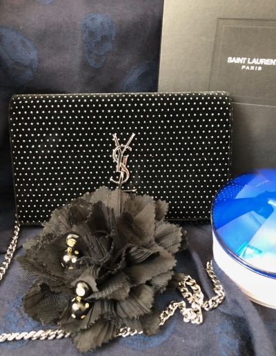 Yves Saint-Laurent bag and earrings