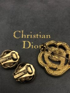 Christian Dior set of clip earrings and brooch